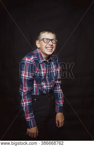 Young Silly Nerd With Glasses With A Dull Smile On His Face