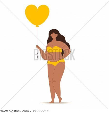 A Happy Beautiful Plump Woman In A Swimsuit Holding A Heart-shaped Balloon. Concept Of Body Positivi