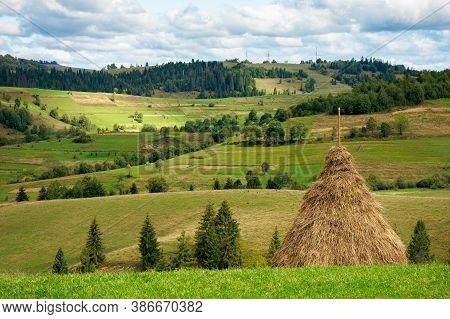 Rural Fields On Rolling Hills. Green Countryside Scenery In Early Autumn. Beautiful Mountain Landsca