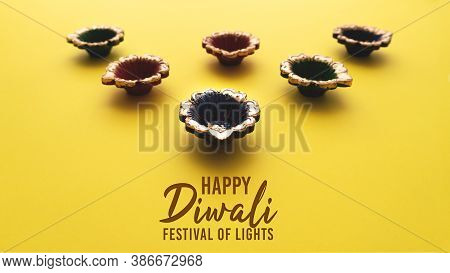 Happy Diwali - Clay Diya Lamps During Dipavali, Hindu Festival Of Lights Celebration. Colorful Tradi