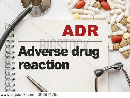 Page In Notebook With Adr Adverse Drug Reaction On White Background With Stethoscope And Group Of Pi