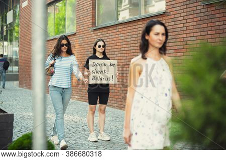 Dont Be Silent, Belarus. Dude With Sign - Woman Stands Protesting Things That Annoy Her. Solo Demons