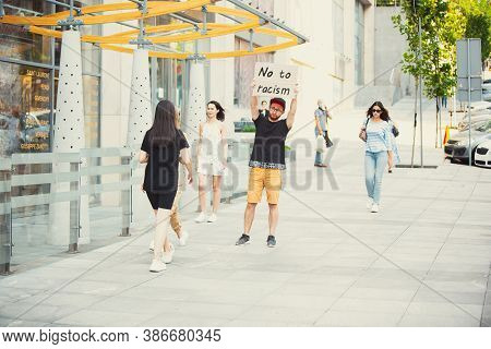 No To Racism. Dude With Sign - Man Stands Protesting Things That Annoy Him. Solo Demonstration His R