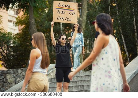 Love Has No Limits. Dude With Sign - Woman Stands Protesting Things That Annoy Her. Solo Demonstrati
