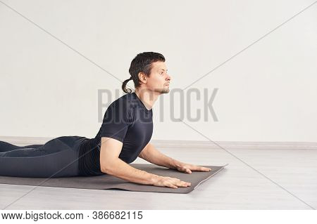Man In Yoga Asana. Home Lockdown Studio. One Person. Gym Fitness. Morning Meditating Exercise. Sport