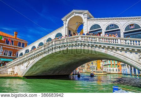 Venice, Italy, September 13, 2019: Venice Cityscape With Rialto Bridge Across Grand Canal Waterway,
