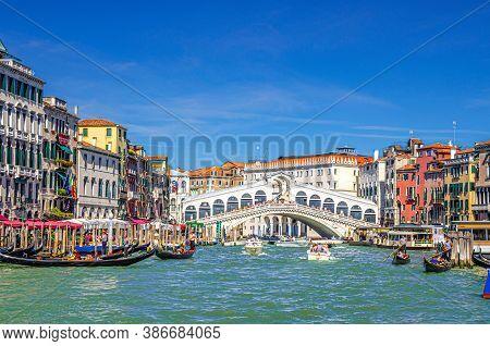 Venice, Italy, September 13, 2019: Cityscape With Rialto Bridge Across Grand Canal Waterway, Venetia