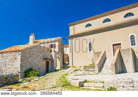 Ancient Coastal Town Of Lubenice On The Island Of Cres In Croatia, Cobbled Streets And Old Houses