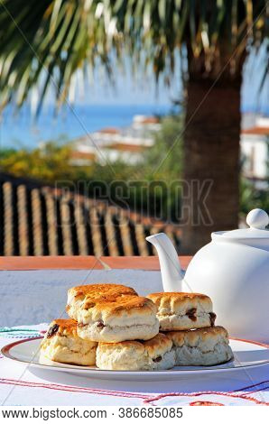 Sultana Scones Stacked On A Plate With Views Towards The Mediterranean Sea, Costa Del Sol, Andalucia