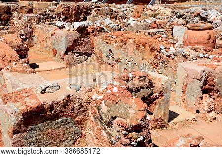 View Of The Ruined Buildings Within The Minoan Malia Ruins Archaeological Site, Malia, Crete, Greece