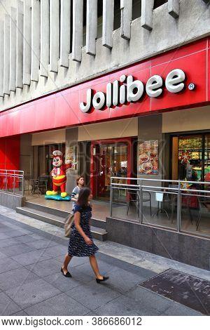 Manila, Philippines - November 28, 2017: People Visit Jollibee Fast Food Restaurant In Manila, Phili