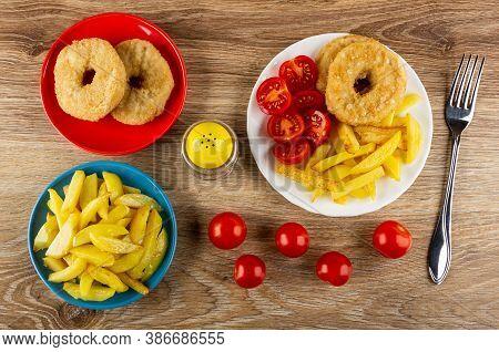 Fried Potato In Blue Plate, Chicken Donuts In Red Plate, Pepper Shaker, Chicken Donuts With Fried Po
