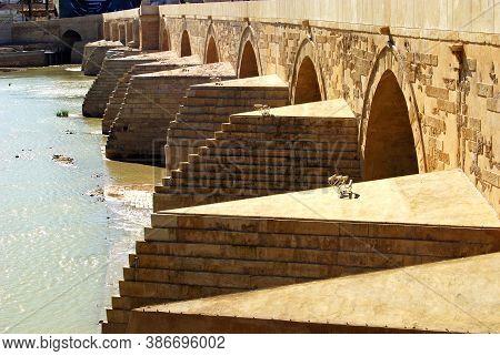 Cordoba, Spain - April 01, 2008 - First Century Roman Bridge (post 2007 Restoration) Across River Gu