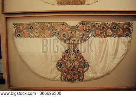 Ronda, Spain - May 5, 2008 - Elaborate Matador Cape Mounted On The Wall In The Bullfighting Museum I