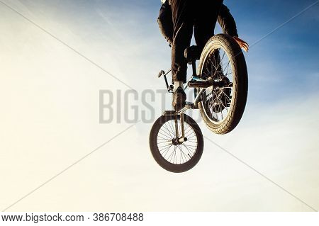 Urban Biker Performing Acrobatic Jump At Sunny Sky - Guy Riding Bmx Bicycle At Extreme Sport Competi