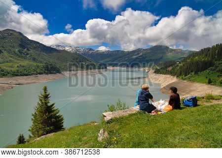 A Picnic Near The Lake Of Roselend, French Alps