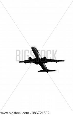 Silhouette Of Contemporary Jetliner On The Climbout After Take-off From Airport, Black And White Ima
