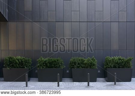 Big Gray, Metal Planters With Foliage Plants And Terrace Design With A Modern Mix Of Construction Ma
