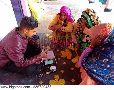 District Katni, India - January 16, 2020: Indian Bank Officer Collecting Installment For Micro Finan