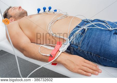 Ecg Electrodes On Male Wrist For Measurement Pulse Trace. Process Of Heart Diagnostic, Part Of Serie