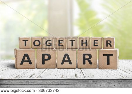 Together Apart Sign Regarding Social Distancing At Work And At Home. Information On A Worn Table In