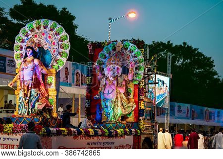 Kolkata, West Bengal, India, October 11, 2019 : Lord Ganesha And Kartika Idol Background. People Cel