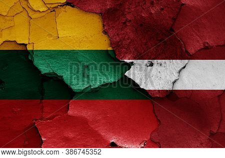 Flags Of Lithuania And Latvia Painted On Cracked Wall