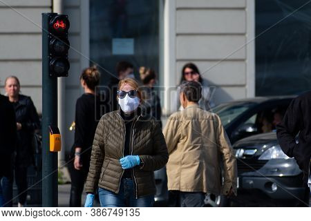 Vilnius, Lithuania - September 20 2020: Woman With Mask And Gloves Walking In The City Center Near R
