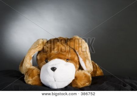 poster of a generic dog stuffed animal posing for the camera.