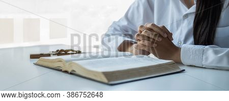 Christian Woman Praying On Holy Bible And Wooden Cross. Woman Pray For God Blessing To Wishing Have