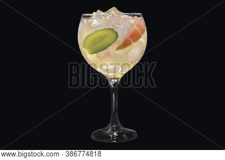 Gin Fizz Cocktail In A Luxury Glass With Ice Cubes, Isolated On Black Background