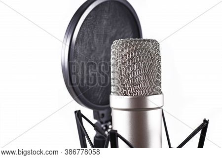 Cose Up Of Vocal Recording Set Including Microphone And Pop Filter Isolated On White Background