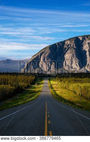 Scenic Route, Alaska Hwy, During A Sunny And Cloudy Day. Mountains In Background. Near Haines Juncti