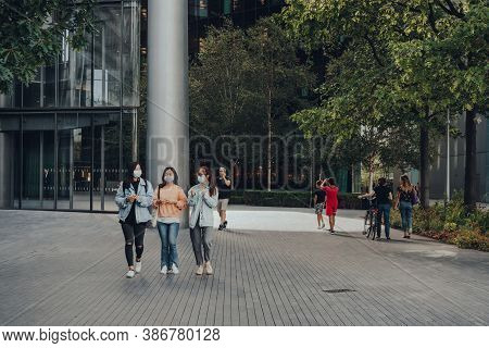 London, Uk - August 25, 2020: Women In Face Masks Walk On More London, A Part Of London Bridge City