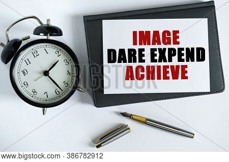 Business And Positive Concept. On The Table There Is A Clock, A Pen, A Notebook And A Card On Which