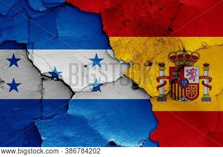 Flags Of Honduras And Spain Painted On Cracked Wall
