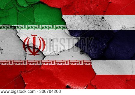 Flags Of Iran And Thailand Painted On Cracked Wall