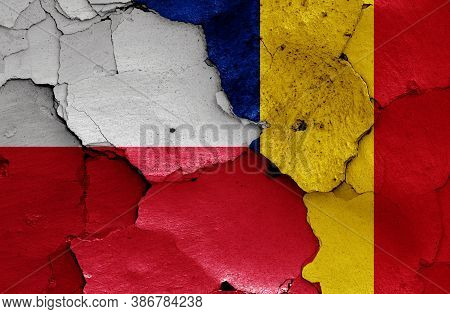 Flags Of Poland And Romania Painted On Cracked Wall