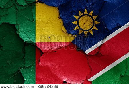 Flags Of Benin And Namibia Painted On Cracked Wall