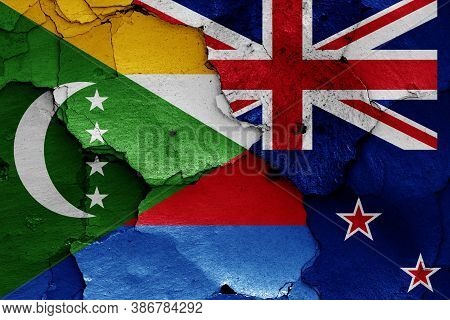 Flags Of Comoros And New Zealand Painted On Cracked Wall