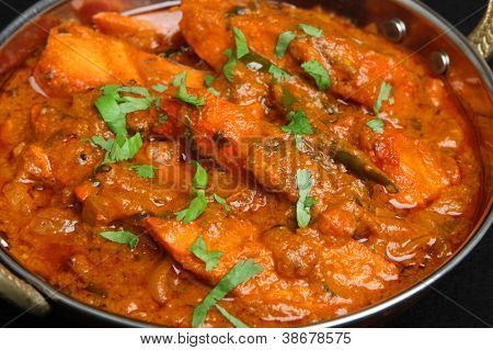 Indian chicken tikka jalfrezi curry in balti dish.
