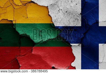 Flags Of Lithuania And Finland Painted On Cracked Wall