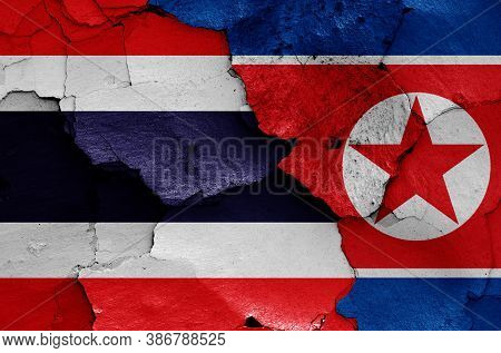 Flags Of Thailand And North Korea Painted On Cracked Wall