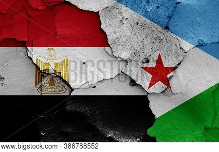 Flags Of Egypt And Djibouti Painted On Cracked Wall