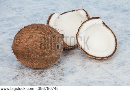 Whole Coconut And Coconut Chunks; Coconut Tropical Fruit (cocos Nucifera).