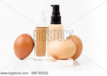 Liquid Fluid Foundation Glass Bottle And Eggs Isolated On White Background. Choose Tone Color Founda