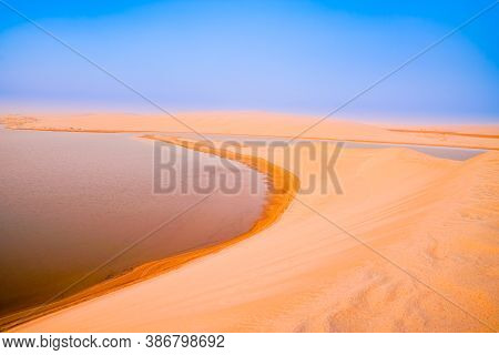 Desert At Sunrise, Golden Hue And Layered Almost Abstract Colors Before The Sun Rises Over Sealine D
