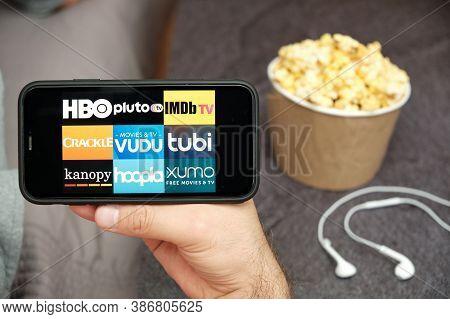 Hbo, Pluto Tv, Imdb Tv, Crackle, Vudu, Tubi, Kanopy, Hoopla, Xumo Logo On The Mobile Phone Screen Wi