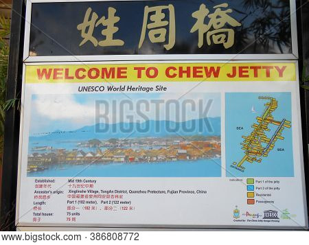 Georgetown, Penang, Malaysia, November 13, 2017: Welcome Sign With A Photo And Map Of Chew Jetty, Th