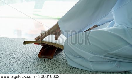 Portrait Of An Asian Muslim Man Reciting Surah Al-fatiha Passage Of The Qur'an, In A Daily Prayer At